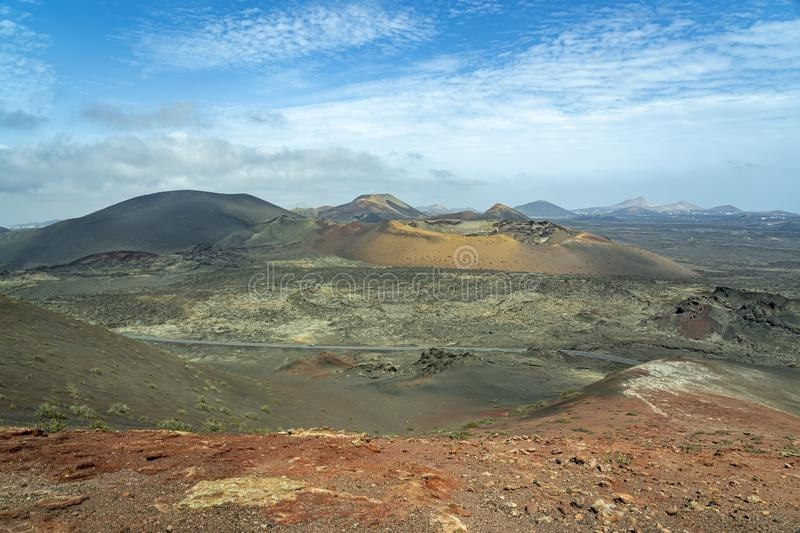 The many shades of color in the volcano landscape with its many craters on the island of Lanzarote, Spain.  stock photography