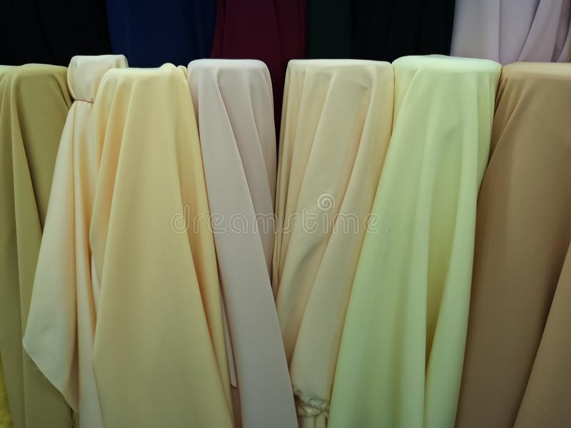 Many shades of yellow fabric for cutting clothes. Soft stock photos
