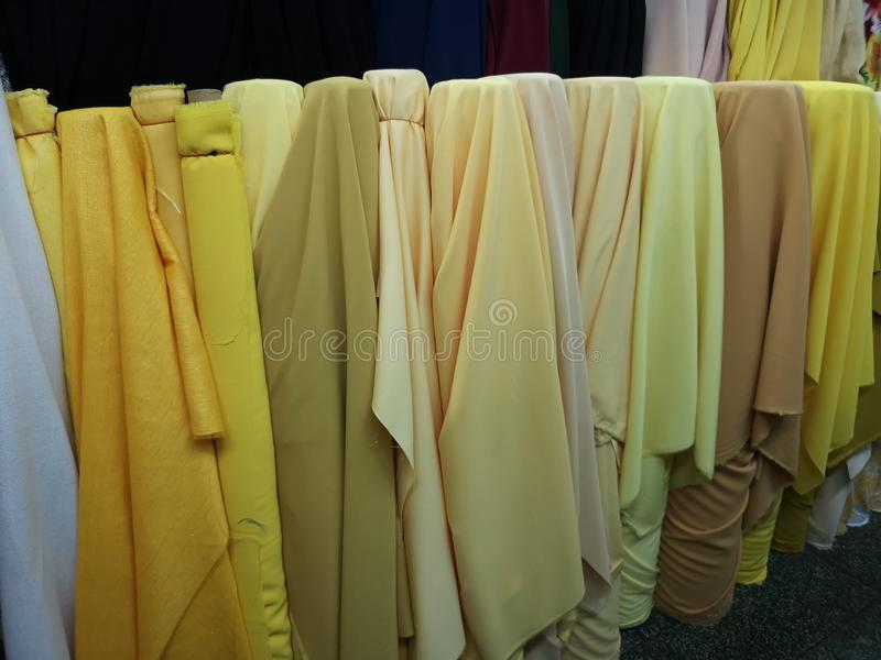 Many shades of yellow fabric for cutting clothes. Soft stock photography