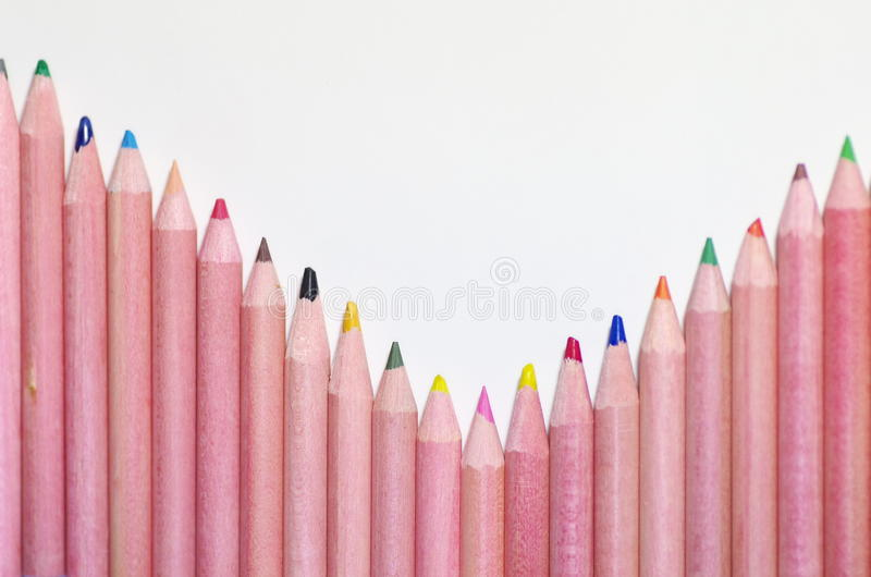 Many sharpened color pencils. Against white background stock images