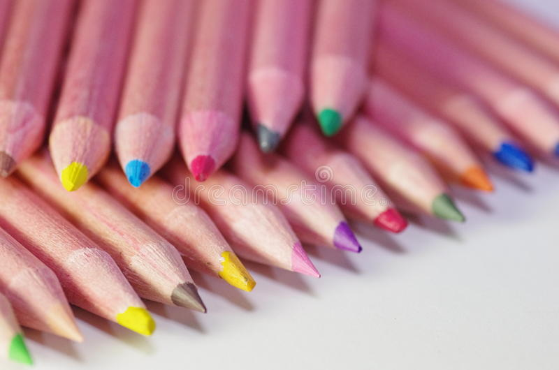 Many sharpened color pencils. Against white background royalty free stock image