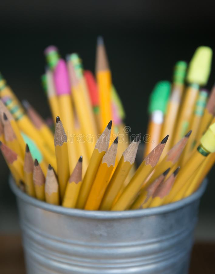 Bucket of sharp pencils ready for use. Many sharpened pencils ready to write your story royalty free stock image