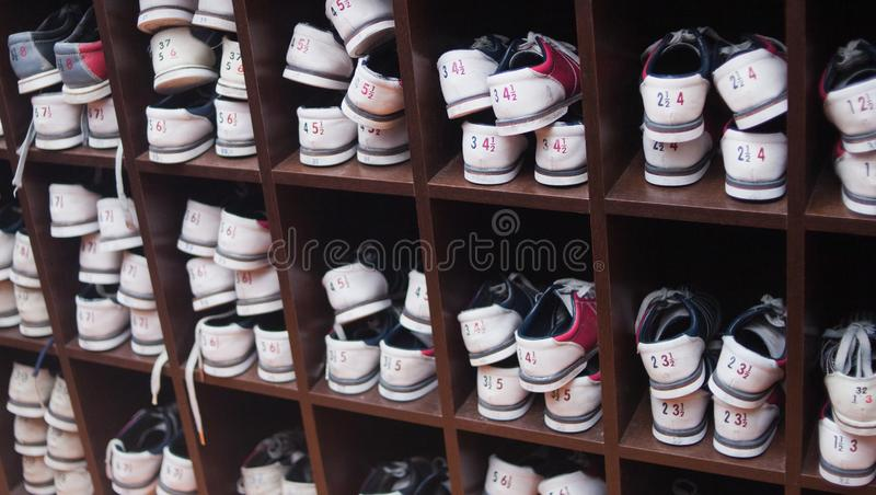 Many shelves with shoes for bowling. stock photo