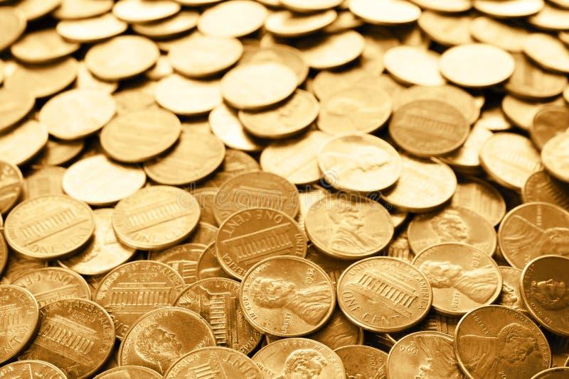 Many shiny USA one cent coins royalty free stock image