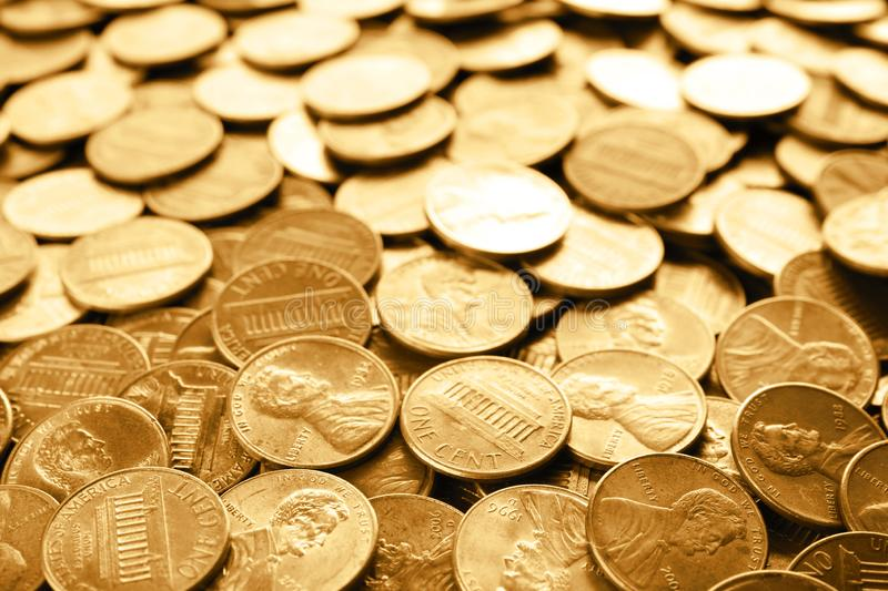 Many shiny USA one cent coins. As background stock photography