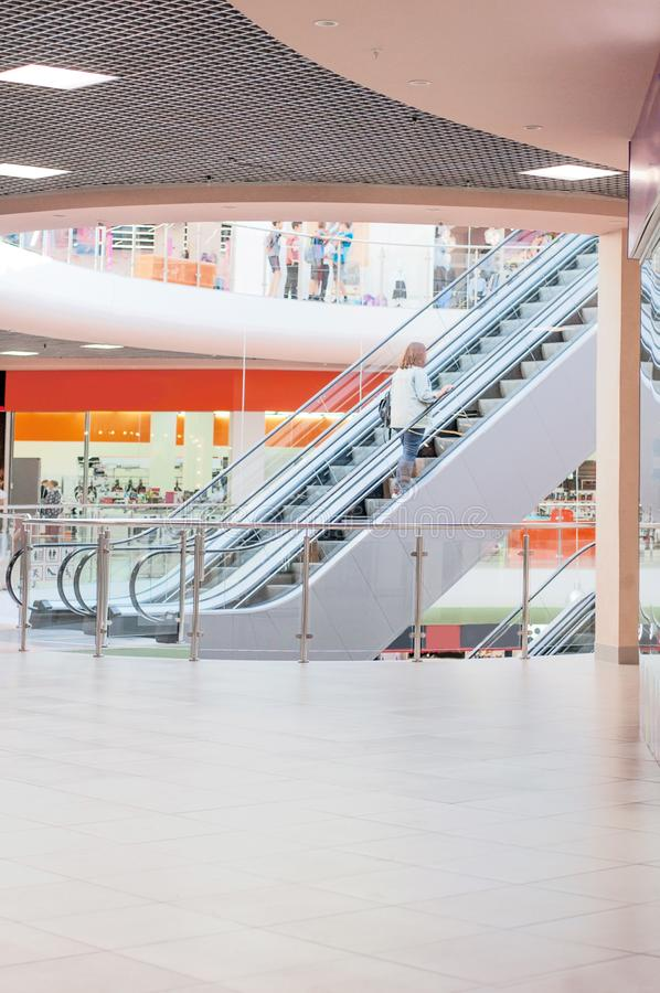 Many shops in the mall with escalator, Background of modern store. Multi-story shop stock images