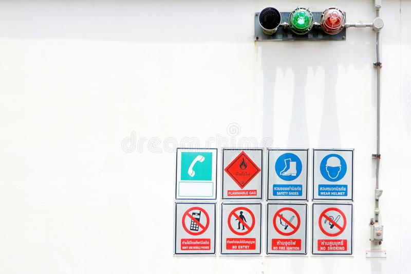 Many sign in dangerous area, Flammable GAS, SAFETY SHOES, WEAR HELMET, DO NOT USE MOBILE PHONES, NO ENTRY, NO FIRE IGNITION, NO stock photography