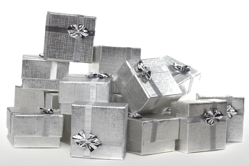 Many silver gifts in a pile on white stock image