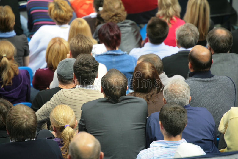 Many sitting people behind stock photography