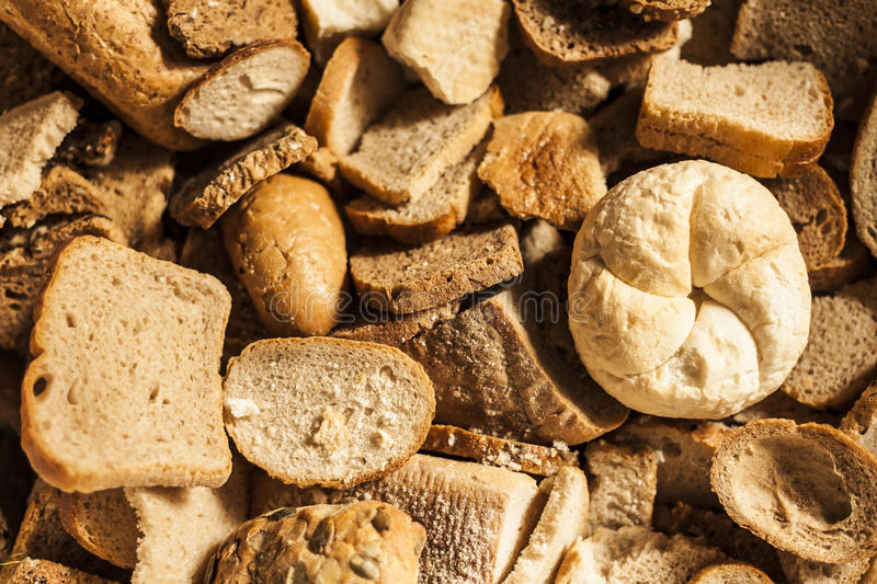 Many slices of stale bread and baked goods. Many slices of stale bread and other stale baked goods royalty free stock images