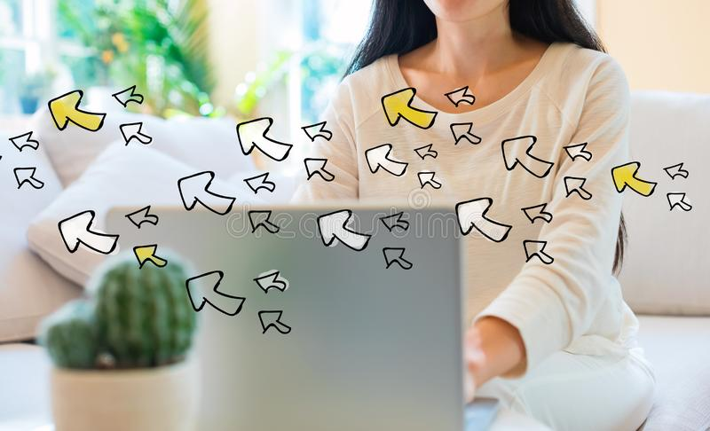 Many small arrows with woman using her laptop. In her home office royalty free stock photos