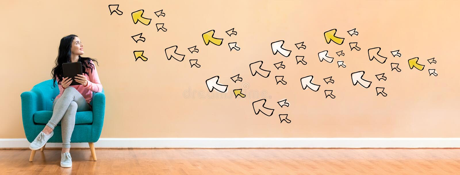 Many small arrows with woman using a tablet. Many small arrows with young woman holding a tablet computer in a chair royalty free stock photography