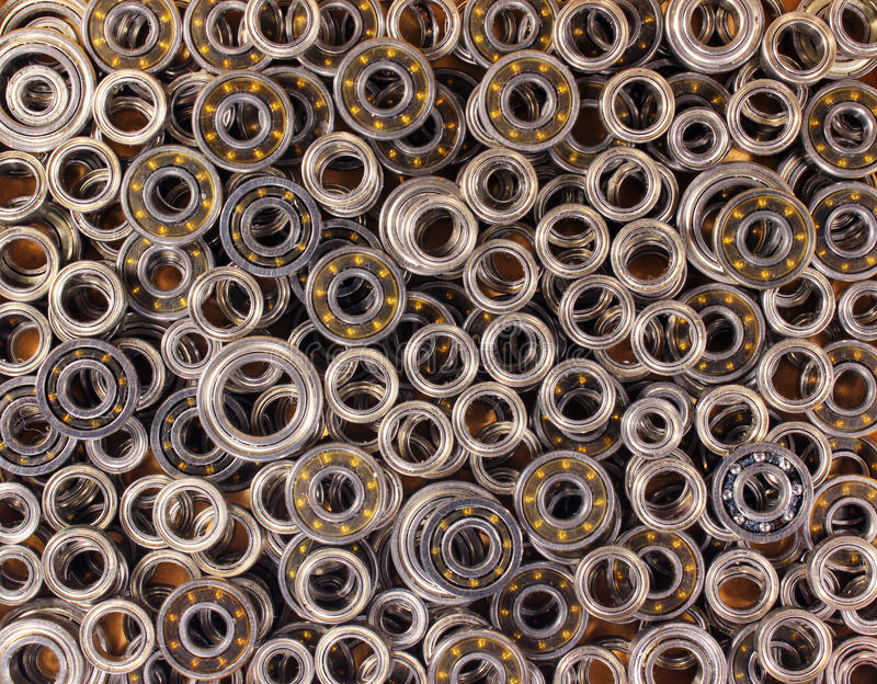 Many small ball bearings. Industrial background royalty free stock image
