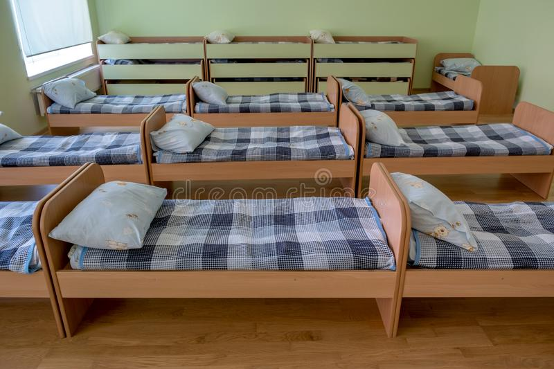 Many small beds in daycare preeschool empty bedroom.  royalty free stock photos