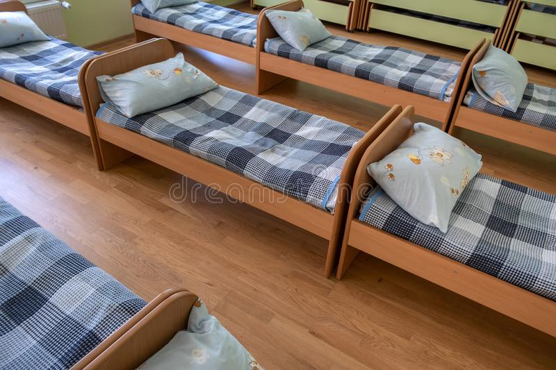 Many small beds in daycare preeschool empty bedroom.  stock photography