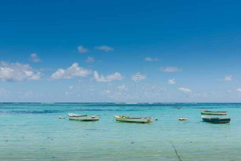 Many small boats near indian ocean coastline. Four small boats near indian ocean coastline royalty free stock images