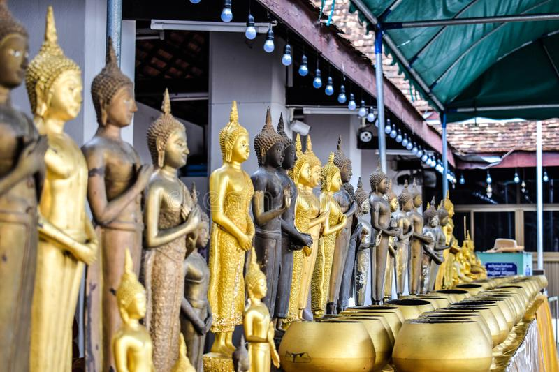 Many small Buddha statue and Many monk& x27;s bowl or alms bowl, Making merit making the mind clear. royalty free stock photography