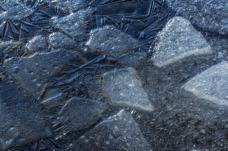 Many small cracked ice sheets royalty free stock images