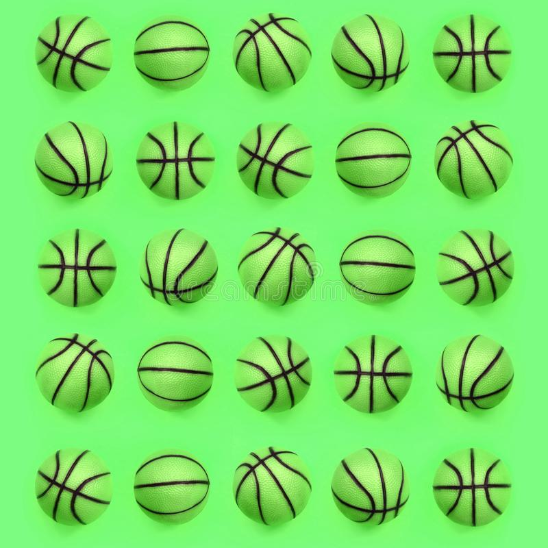 Many small green balls for basketball sport game lies on texture background stock photo