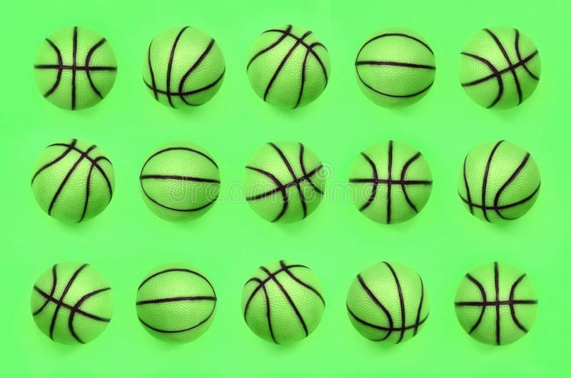 Many small green balls for basketball sport game lies on texture background royalty free stock photography