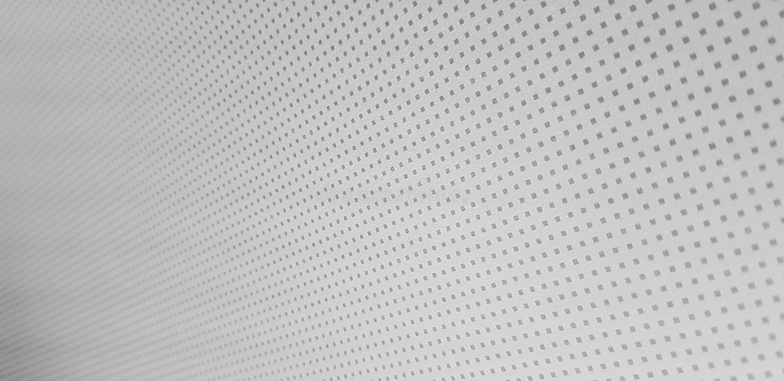 Many small grey square dots line texture. Many small grey square dots line on the white plain texture royalty free stock photos