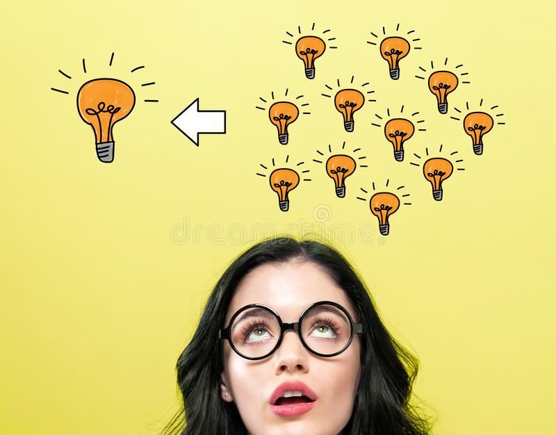 Many small ideas into one big idea with young woman royalty free stock photo