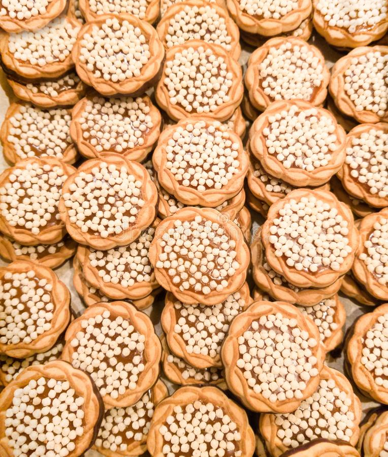 Many small round cookie with small puffed rice stock images