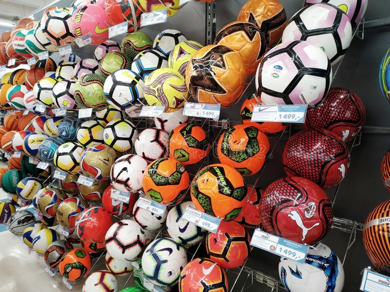Many soccer balls of different brands are sold in the sports shop Sportmaster stock images