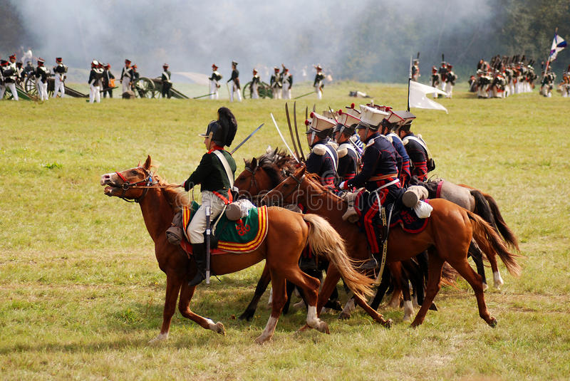 Many soldiers-reenactors fight on the battle field. stock photo