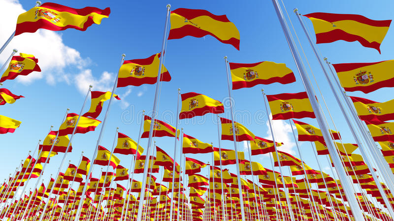 Many Spain Flags on flagpoles against blue sky. royalty free illustration