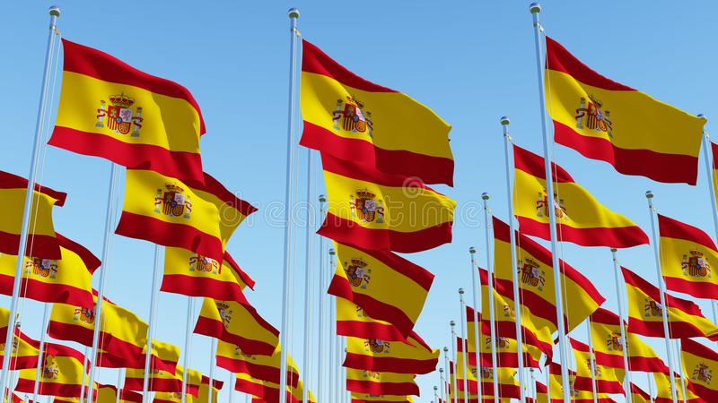 Many Spain flags in rows waving against clear blue sky royalty free illustration