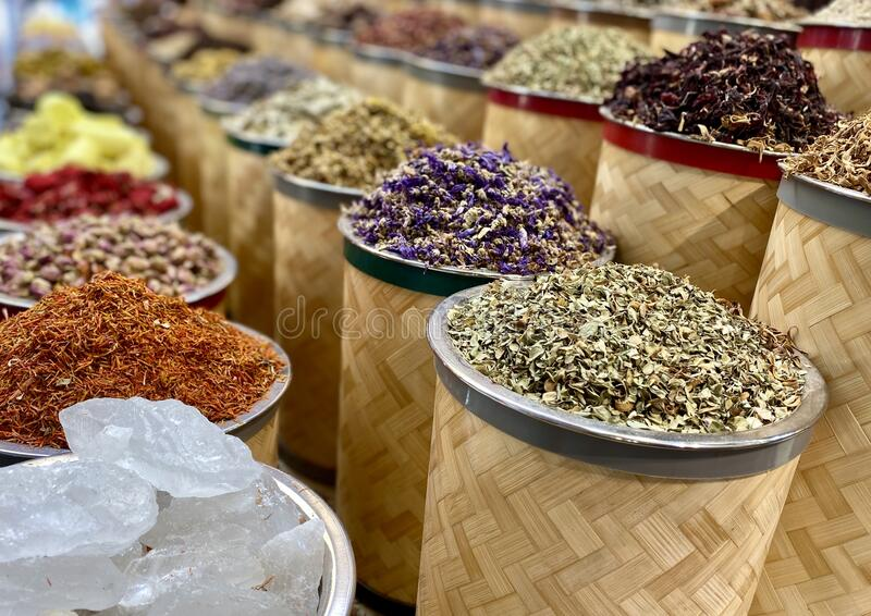Spices in old Dubai spice market. Many spices lined up in old Dubai spice market in wicket baskets stock photos