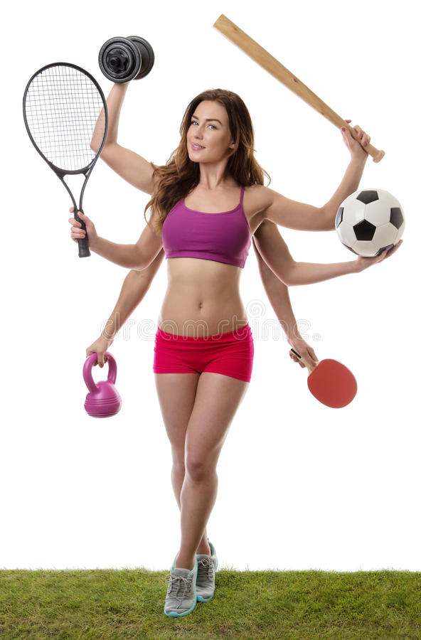 So many sport to choose from. Fitness woman with six arm holding different sports items standing on grass shot in the studio royalty free stock photography