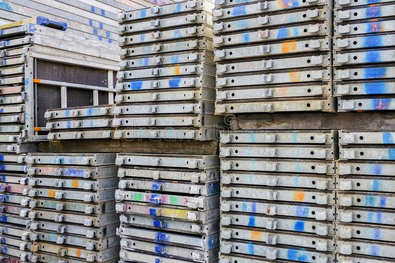 Many stack of steel scaffold stuffs at warehouse royalty free stock photography