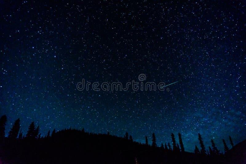Many stars on blue dark night sky as a cosmos background. Many stars on blue dark night sky as a cosmos background stock photos