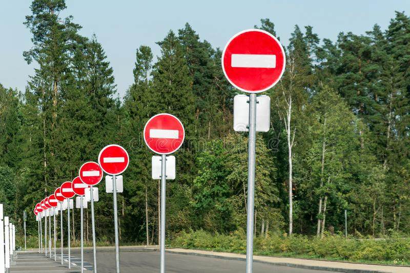 Many stop signs in a row in the parking lot.  royalty free stock image
