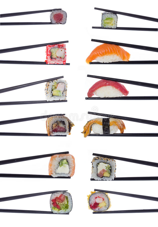 Many sushi rolls in chopsticks isolated on white royalty free stock photos