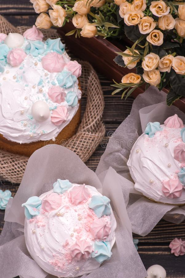 Many tasty cakes lie on a dark wooden table, view from above stock photography