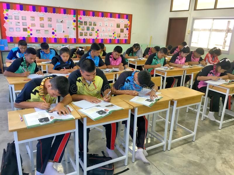 Many Thai students in their uniform are studying the lesson togt royalty free stock photography