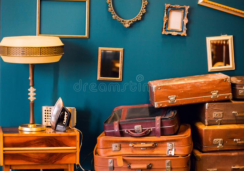 Many things - suitcases, a lamp, an iron, photo frames - in one room. Photo of Many things - suitcases, a lamp, an iron, photo frames - in one room royalty free stock photography