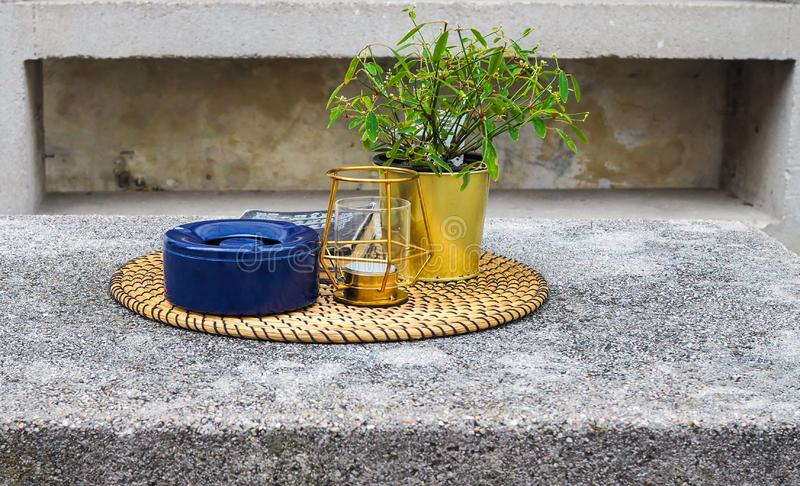 Many things on tray. Food carrier, lamp, flower pot and book on wooden tray stock photography