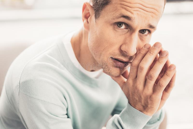 Mindful mature man having many thoughts stock image