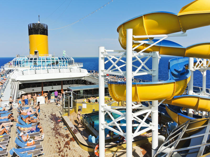 Many tourists relaxing on the deck of cruise liner stock photo