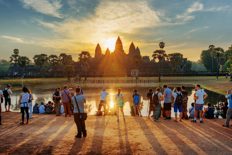 Many tourists taking picture of Angkor Wat at sunrise stock photos