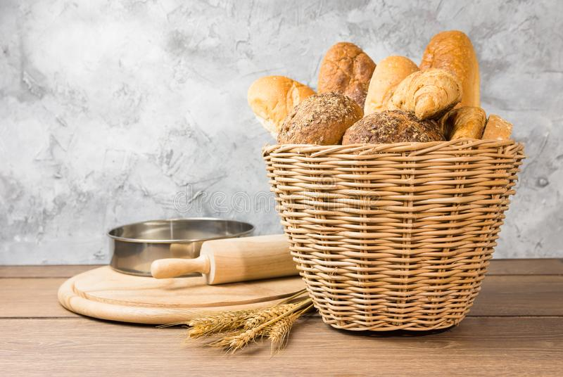 Many types of bread in wicker baskets royalty free stock photos