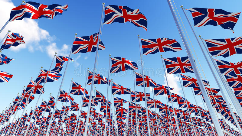Many United Kingdom flags waving in the wind in blue sky. royalty free illustration