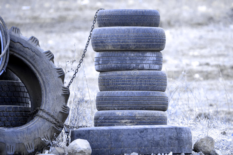 Many used old tires in outdoor background. Landscape many used old tires in outdoor background stock image