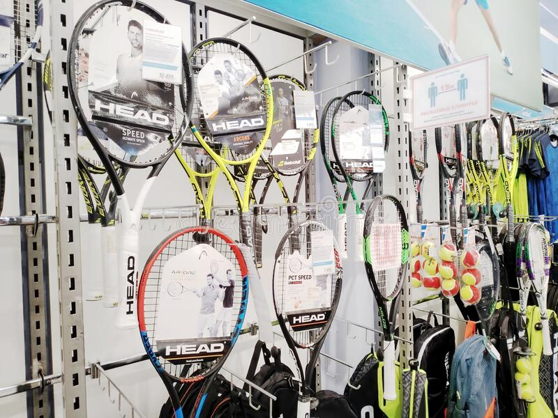 Many various badminton rackets sold at a sports store stock photo