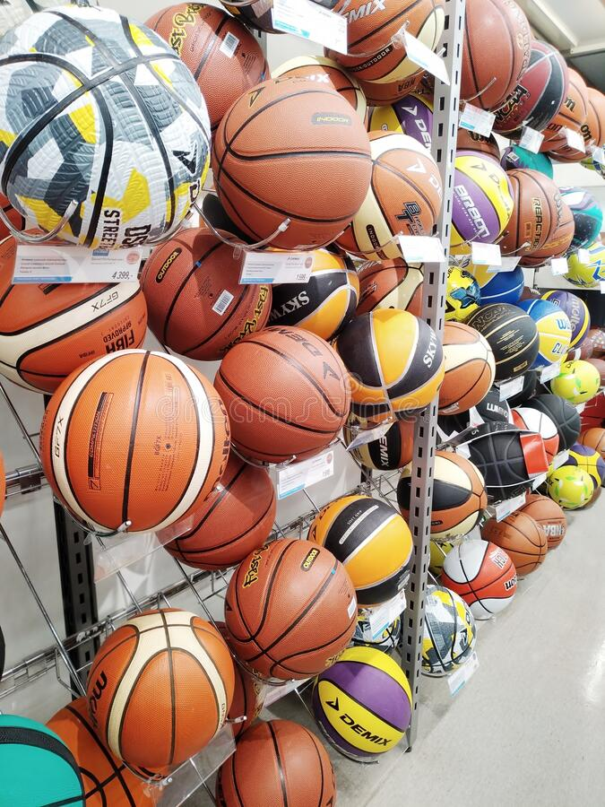 Many various basketball balls are sold at a sports store stock images