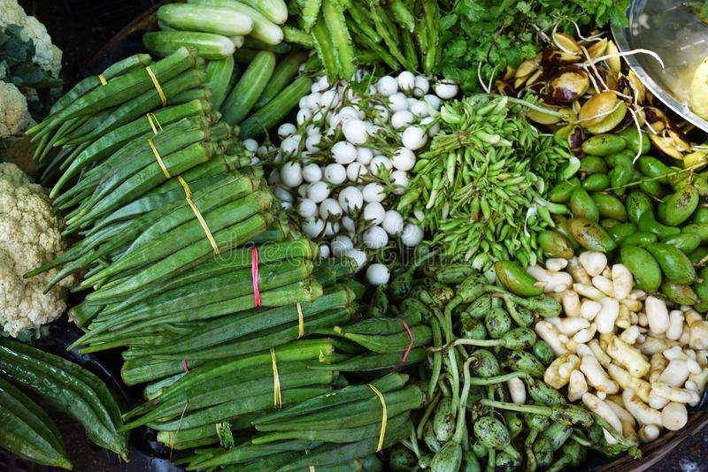 Many vegetable selling at street stall vendor at traditional agriculture market. Many vegetable selling at retail street stall vendor at traditional agriculture royalty free stock photo